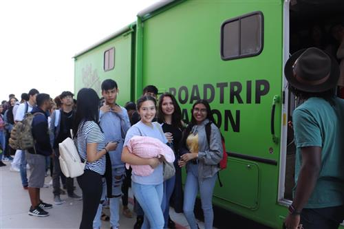 Students stand outside the Roadtrip Nation RV