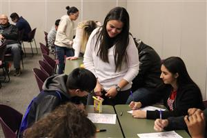 Empowering Hands Counselor assisting Students at Charting the Course event, Day 2